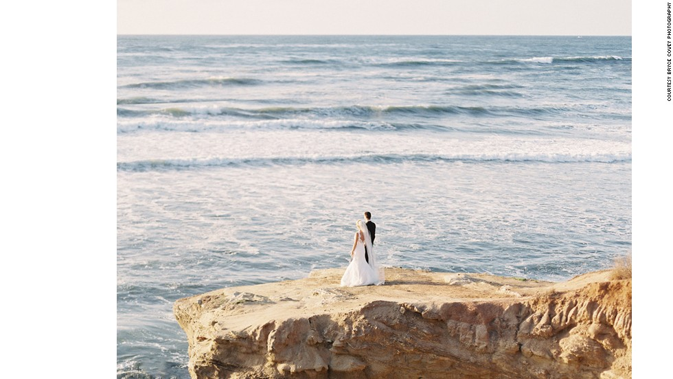 "For this California wedding, newlyweds were photographed on dramatic coastal bluffs. ""The rocky path down the cliff in this photo was not the most convenient nor high-heel friendly, but the bride took off her shoes to walk down the cliff,"" says Bryce Covey of Bryce Covey Photography. ""It resulted in one of their and my own favorite photos of the wedding day!"""
