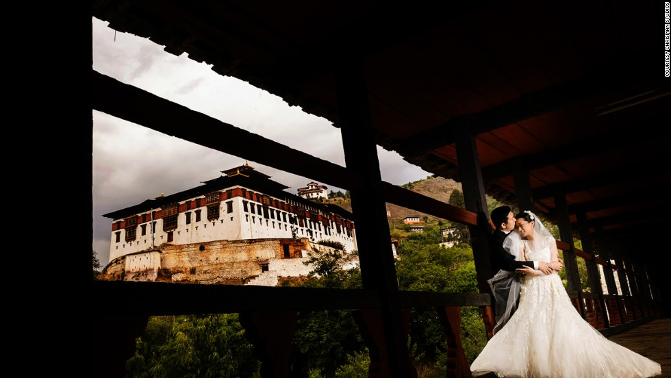 "Taiwanese couple Christine and Chiaming flew to Bhutan for their wedding. ""Christine loved the architecture of the traditional homes and temples, so it was important to us to show both the landscape and the architecture in the photos,"" says Ben Chrisman of <a href=""http://chrismanstudios.com "" target=""_blank"">Chrisman Studios</a>, who took their wedding pics. ""You have to really show what makes the place unique. You don't want the wedding photos to look like they could have been shot anywhere."""