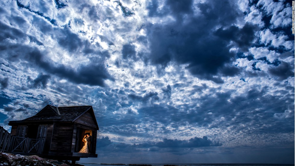 "While choosing Half-Moon Resort for their wedding, one couple noticed this little hut, actually a massage room for the hotel's spa. ""We had a limited amount of time for portraits before the ceremony, so we were rushing around trying to hit all the desired spots,"" says Chrisman. ""This photo captures the dramatic, cloudy sky we had that day."""