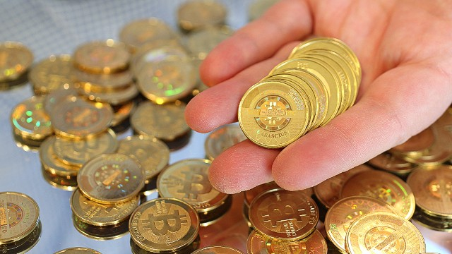 SALT LAKE CITY, UT - APRIL 26: Software engineer Mike Caldwell holds physical Bitcoins he minted in his shop on April 26, 2013 in Sandy, Utah. Bitcoin is an experimental digital currency used over the Internet that is gaining in popularity worldwide. (Photo by George Frey/Getty Images)