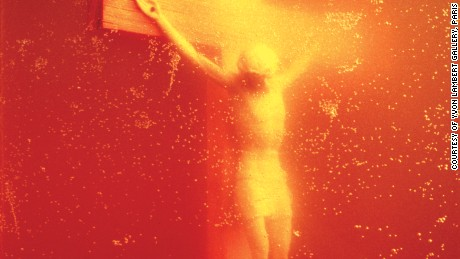 """Andres Serrano """"Piss Christ"""", 1987 """"Piss Christ"""" is a photograph of a crucifix submerged in a glass of Serrano's urine. In 1989, it ignited a congressional debate on US public arts funding and in 2011 French Catholic fundamentalists attacked and destroyed the photograph with hammers."""