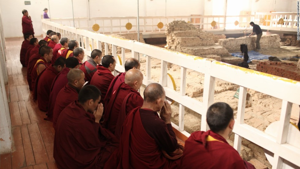 Monks chant within the Maya Devi Temple, which enshrines the Buddha's birthplace, at Lumbini in Nepal.