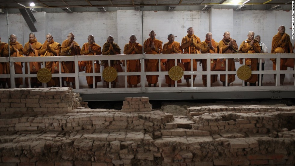 Thai monks inside the Maya Devi Temple meditate over the remains of the oldest Buddhist shrine.