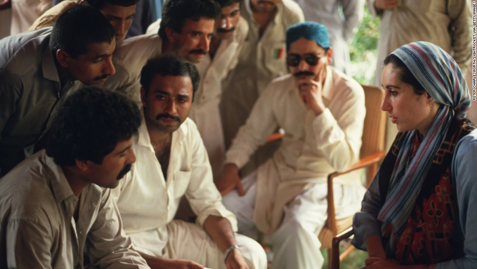 Bhutto meets with a group of male supporters at her family home in Larkarna after returning to Pakistan from London to lead her late father's party, the Pakistan People's Party, in 1986.