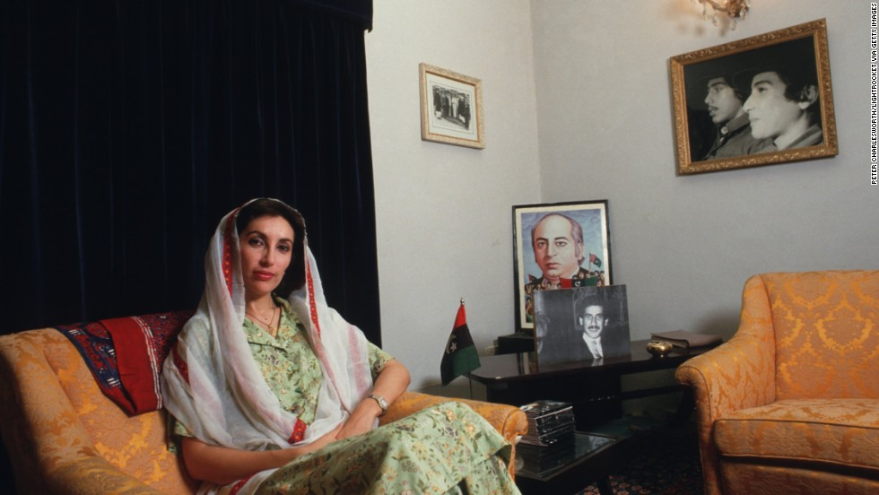 Bhutto at her family's home in Larkarna. Behind her is a picture of her father, Zulfikar Ali Bhutto, who in 1979 was hanged for the murder of a political opponent two years after he was ousted as prime minister in a military coup.