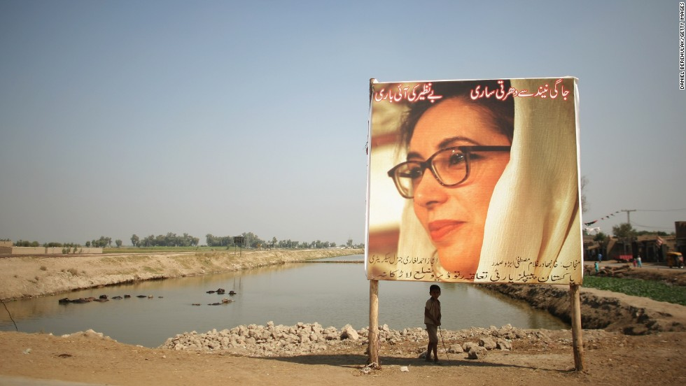 A boy stands underneath a billboard of Bhutto in Larkana on October 23, 2007. A month later Bhutto was fatally injured when a gunman fired shots then detonated a suicide bomb during a rally in Rawalpindi. In August 2013, a Pakistani court indicted President Pervez Musharraf in Bhutto's death.