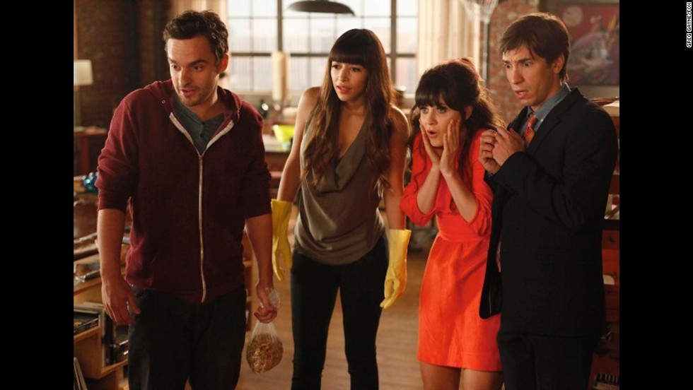 "In first Thanksgiving episode of ""New Girl,"" Jess (played by Zooey Deschanel, second from right) invites her cruhh Paul (Justin Long, right) to the loft to spend the holiday with her roommates. Cooking mishaps follow, and a shocker. Also pictured are characters Nick Miller (Jake Johnson ) and Cece (Hannah Simone)."