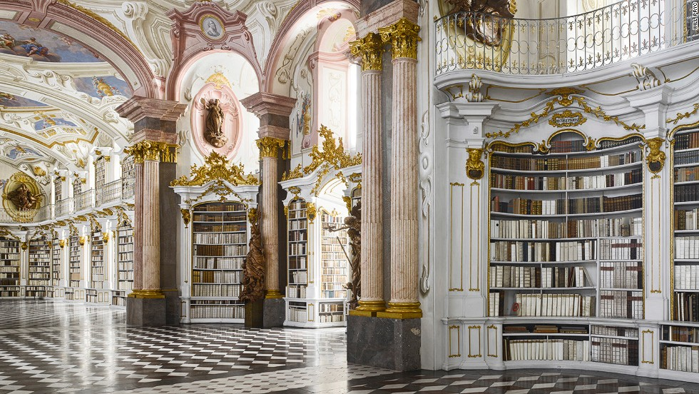 "<em>Admont Abbey library, Admont, Austria</em><br /><strong><br />James Campbell</strong>: ""This is one of the largest monastic libraries ever built. The whole thing is a complete work of art. The corridors and staircase that leads to it is relatively simple, so when you enter this stunning space flooded with light there is almost a moment of revelation, a theatrical effect.  There are no desks to work at because these library rooms were never intended for study, but for impressing visitors. The books were taken back to the monks' warm cells to be read. It was built in 1776, a piece de resistance of rococo design."""