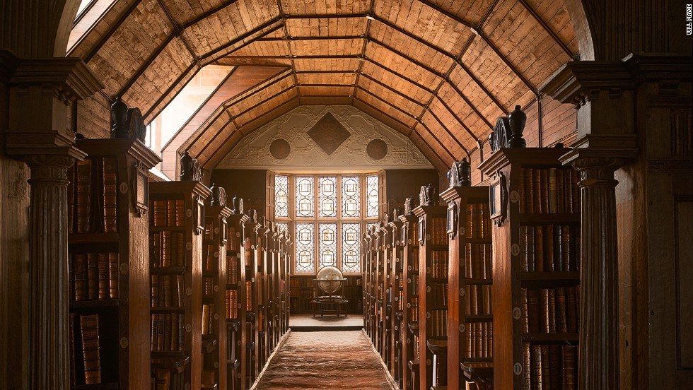 "<em>Merton College Library, Oxford, UK</em><br /><strong><br />James Campbell</strong>: ""Although the building was completed in 1373 and is one of the oldest academic libraries in the world still in continuous daily use, the fittings date from the late sixteenth century. It is less ornate than Rococo libraries in palace or monastery complexes, because universities did not have access to the same amount of money, but it is still extraordinarily beautiful."""