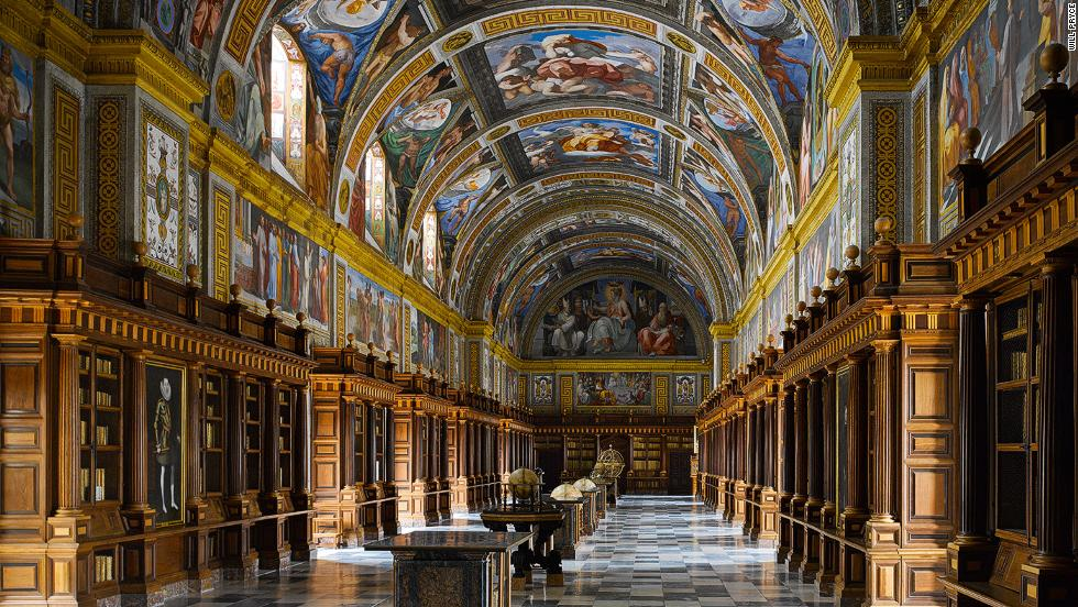 "<em>The Escorial Library, San Lorenzo de El Escorial, Spain</em><br /><strong><br />WIill Pryce</strong>: ""This library was ground-breaking. It established the template of using books to decorate the walls of the library which we've been using ever since. The great hall is a harmonious combination of bookshelves, books and a wonderful painted ceiling. It was complete by 1585 and influenced everything that followed it.""<br />"