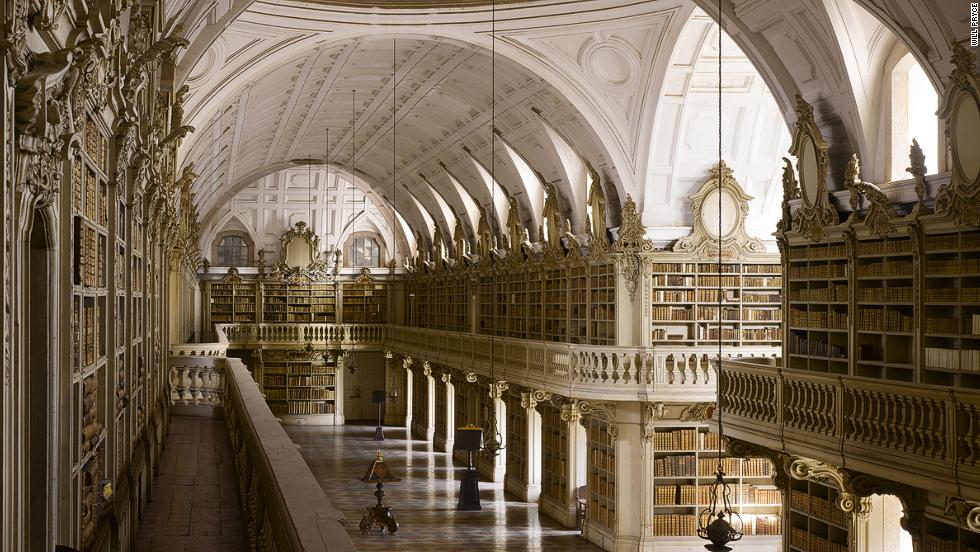 "<em>Mafra Palace Library, Mafra, Portugal </em><br /><strong><br />James Campbell</strong>: ""The Mafra Palace Library in Mafra, Portugal is at 88 meters the longest Rococo monastic library in the world. Sadly the original designs are lost but we think it would have been covered in gold leaf with an ornate painted ceiling. However, because the construction lasted from 1717 to 1771, by the time it was completed a simplified decoration was adopted. The library also hosts a colony of bats who come out at night to feed on the insects who would otherwise eat the books."""