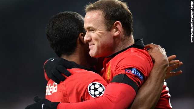 Wayne Rooney celebrates with Antonio Valencia following the winger's opening goal for Manchester United.