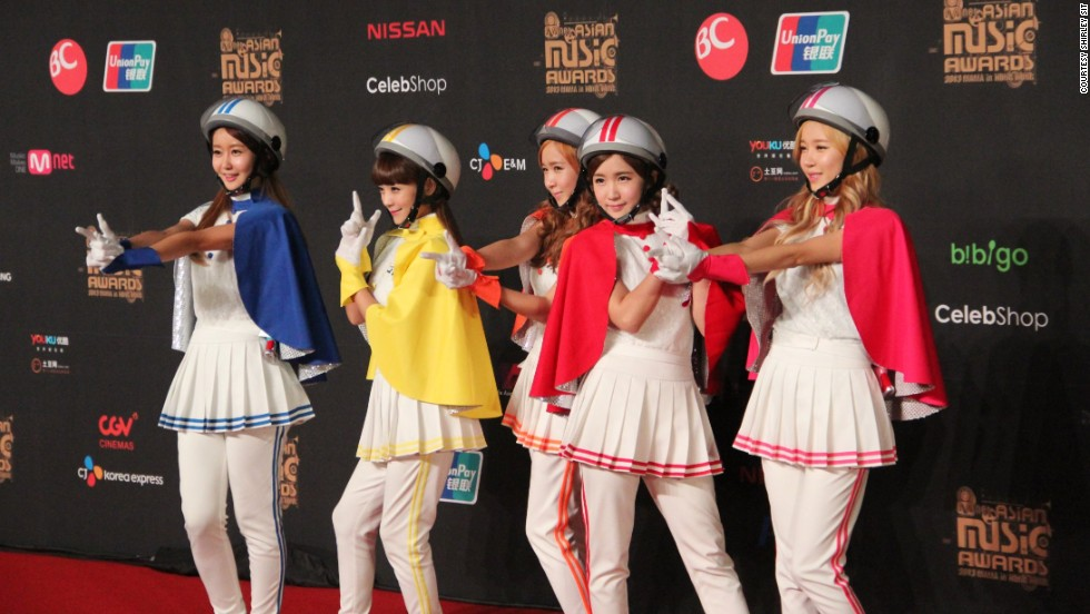 The five-member girl group, Crayon Pop poses in their signature colorful outfits and helmets at Mnet Asian Music Awards in Hong Kong, where they won Best New Female Artist.