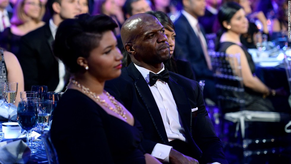 Actor Terry Crews watches the show.