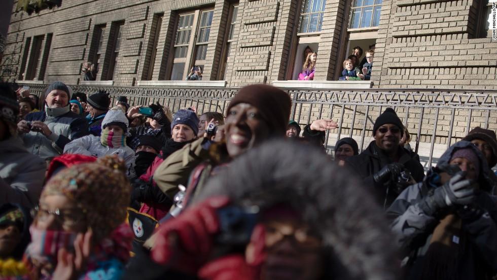 Spectators watch the parade pass along Central Park West.
