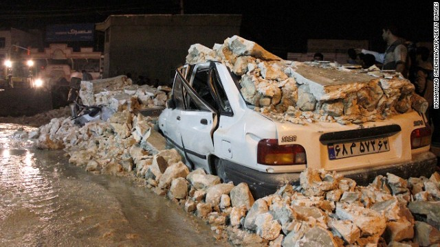 The wreckage of a car amid rubble in the Iranian western city of Borazjan, on November 28, 2013, after an earthquake struck the country, injuring at least 59 people.