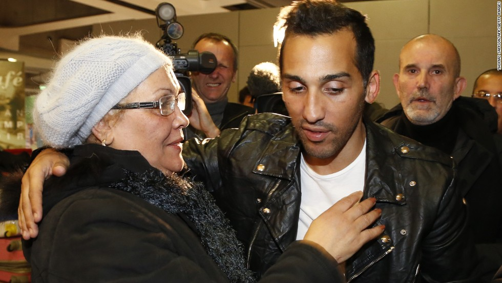 Football player Zahir Belounis is embraced by his mother as he arrives from Qatar at the French Roissy-Charles-de-Gaulle airport on November 28, 2013. The French-Algerian footballer, 33, had been unable to leave Qatar since June 2012, after he filed a complaint against his club Al-Jaish over a payment dispute.