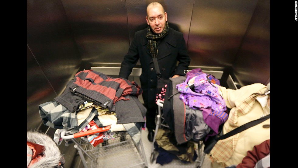 Manuel Diaz Escobar, a tourist from Mexico City, rides in an elevator after shopping at a New York Kmart on November 28.