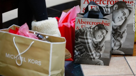 Bags sit on the ground as shoppers hunt for Black Friday deals at Somerset Collection  mall on November 29 in Troy, Michigan.