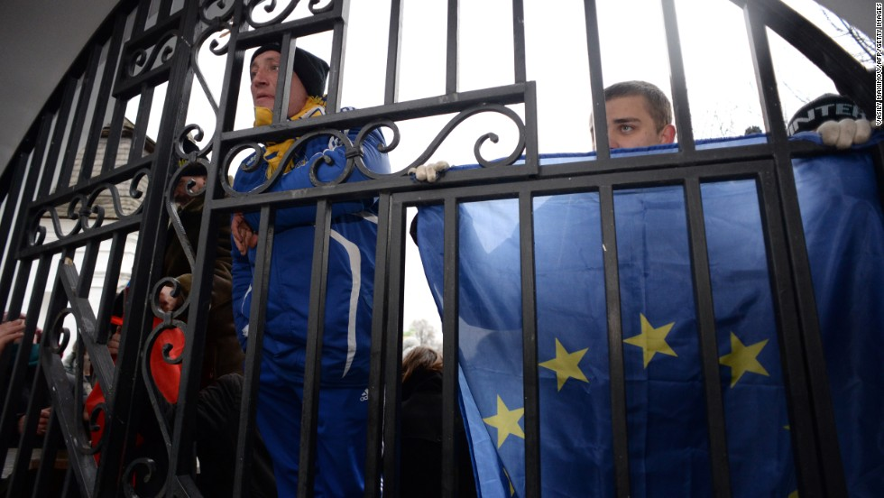 Opposition supporters hold EU flags November 30 as they guard the gates of the Mikhailovsky monastery.