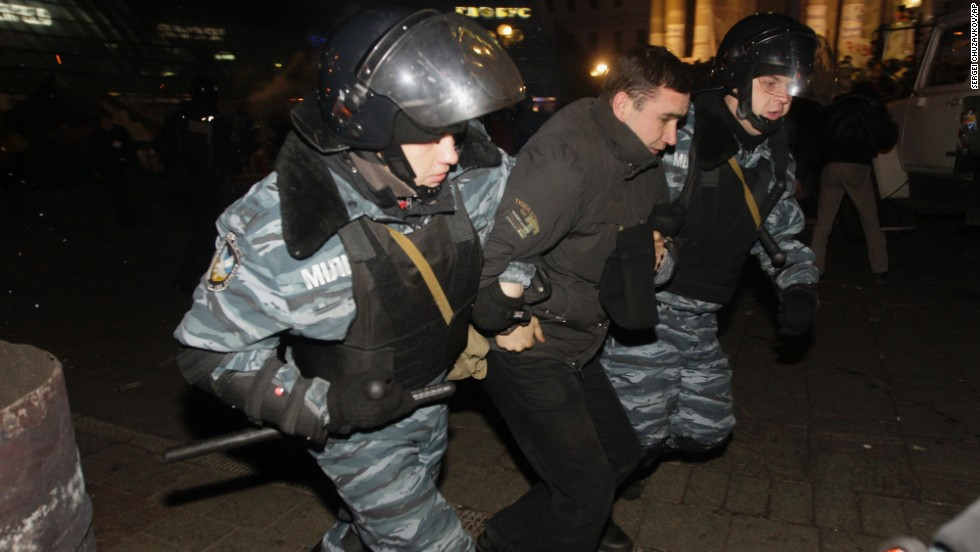 Ukrainian riot police detain a protester on November 30.