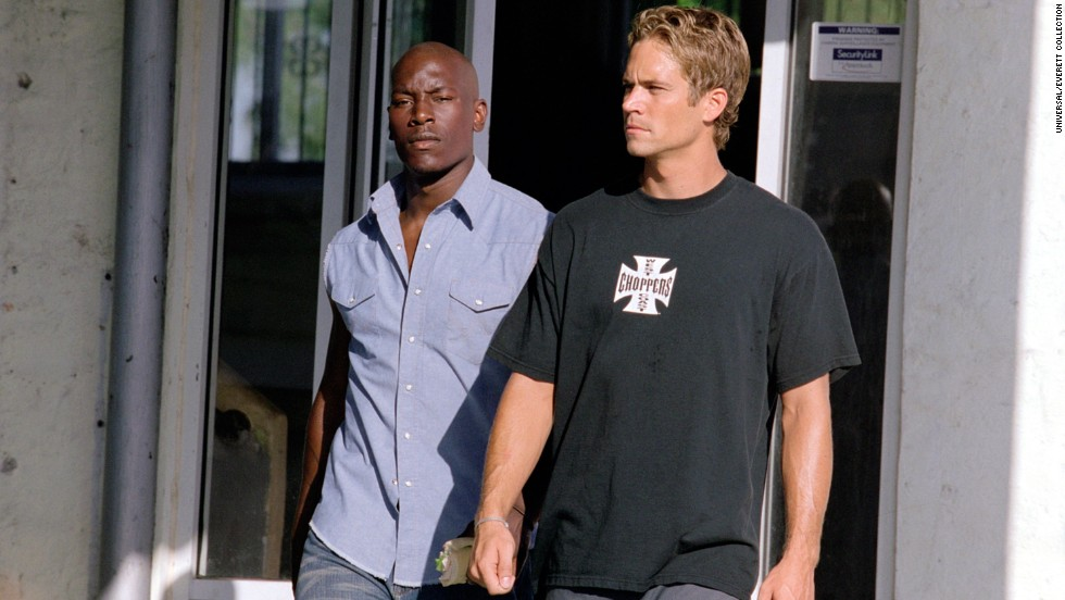 "Tyrese Gibson and Walker appear in ""2 Fast 2 Furious."""
