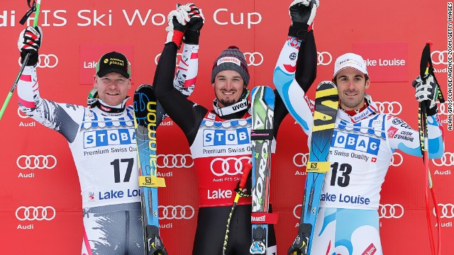 Dominik Paris (center) triumphed in the first men's downhill of the season at Lake Louise in Canada.