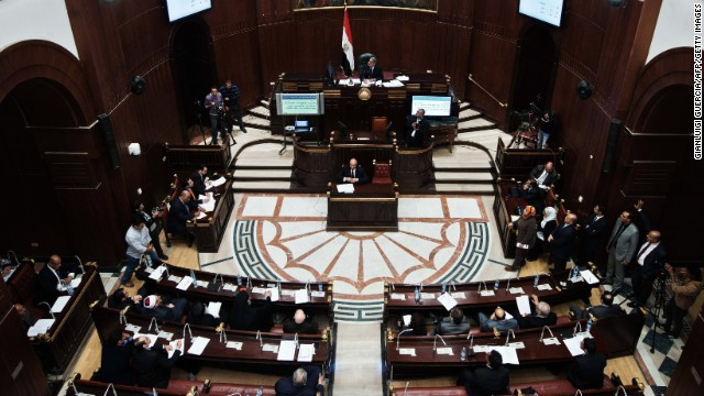 Members of the Egyptian constitutional panel vote on a new constitution at the Shura council in Cairo.