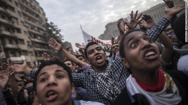 Students backing Mohamed Morsi shout slogans during a demonstration on December 1, in Cairo.