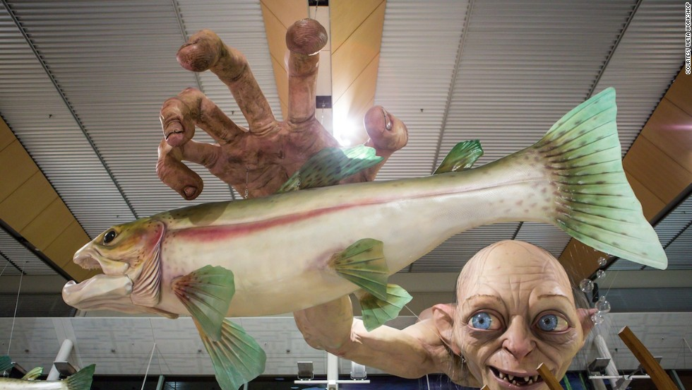 Good luck eating with that staring down at you. Wellington International Airport's new Hobbitt-themed sculptures join this existing installation featuring Gollum fishing for trout, which has been suspended above the airport's food court since late last year.
