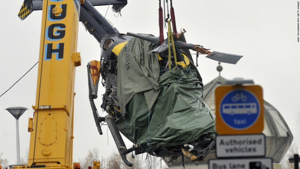 The wreckage of a police helicopter is lifted from the collapsed roof of Clutha pub in Glasgow on Tuesday, December 2. Eight people have been killed and 14 seriously injured since a police aircraft crashed into a downtown pub.