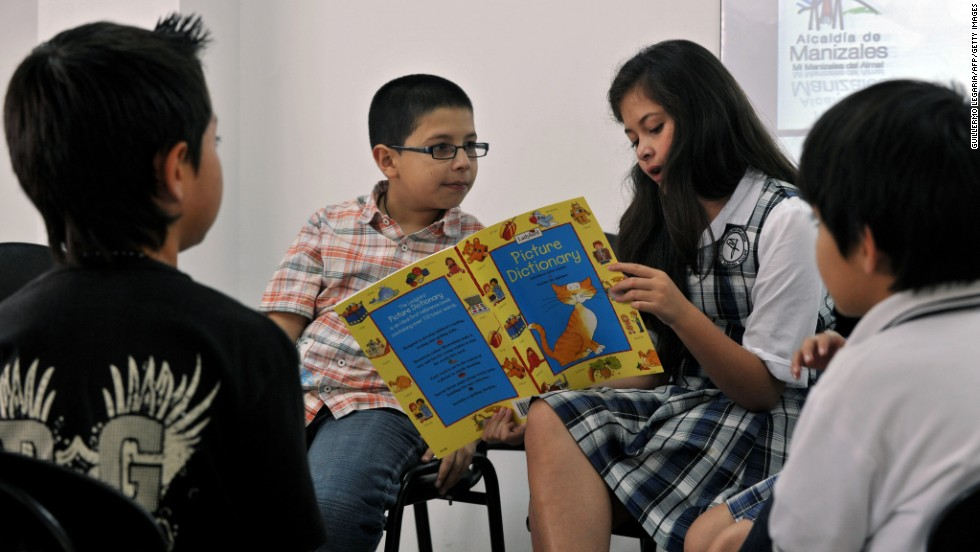 Children attend an English lesson at a public school in Manizales, Colombia. In math, around one in four Colombian students met a level of proficiency considered necessary to participate fully in modern society, according to the OECD.