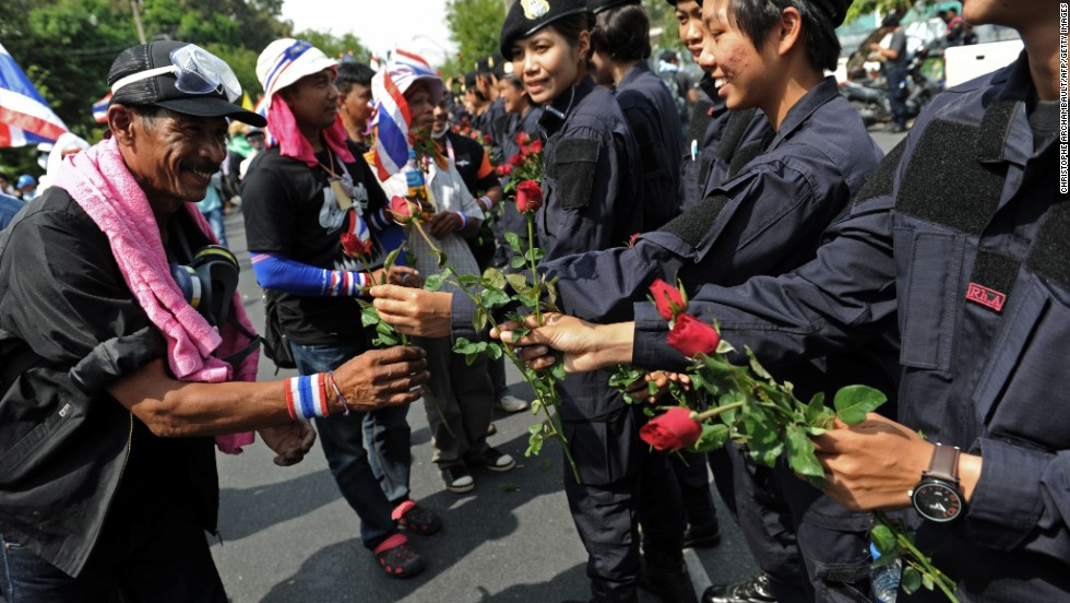 Protesters receive flowers from police officers on December 3.