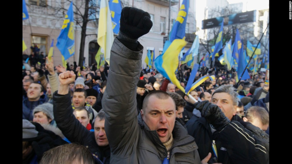 Protesters chant slogans outside the parliament in Kiev on December 3.