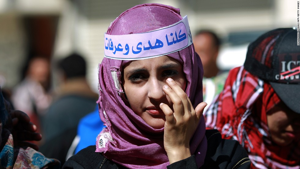 A Yemeni girl takes part in a gathering in support with Saudi young woman Huda al-Niran outside the courthouse during her trial on November 24, 2013 in the capital Sanaa. Niran, 22, was arrested and sued after she fled from Saudi Arabia to Yemen with a Yemeni man after her family refused to let them marry, her lawyer told Human Rights Watch.