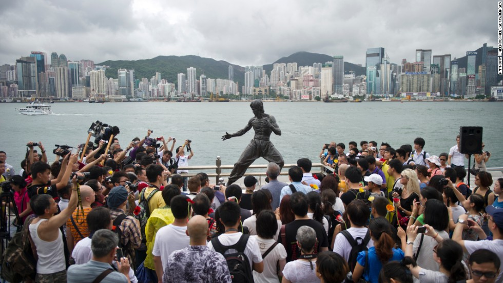 Fans gather around a statue of Bruce Lee in Hong Kong to mark the 40th anniversary of his death on July 20, 2013. Hailed as cinema's first martial arts hero and a cinematic bridge between the cultures of East and West, Bruce Lee helped put Hong Kong on the world movie map.