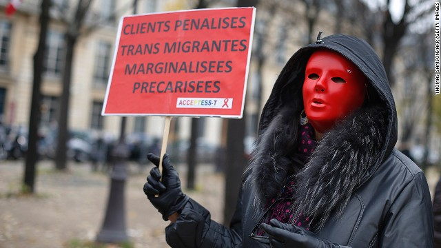 People demonstrate on November 29 in Paris against a bill that would punish those who use prostitutes.