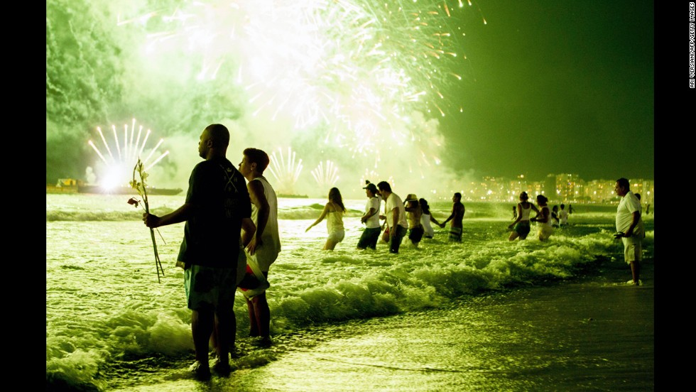 <strong>January 1:</strong> People watch New Year's fireworks along Copacabana Beach in Rio de Janeiro, Brazil. Photographers worldwide captured deadly conflicts, devastating storms and other memorable moments throughout the year. Click through the gallery to see 2013 unfold from beginning to end.