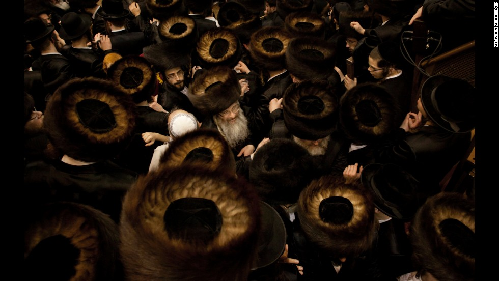 <strong>February 25:</strong> Ultra-Orthodox Jewish men gather at a yeshiva in Jerusalem during the Purim holiday.