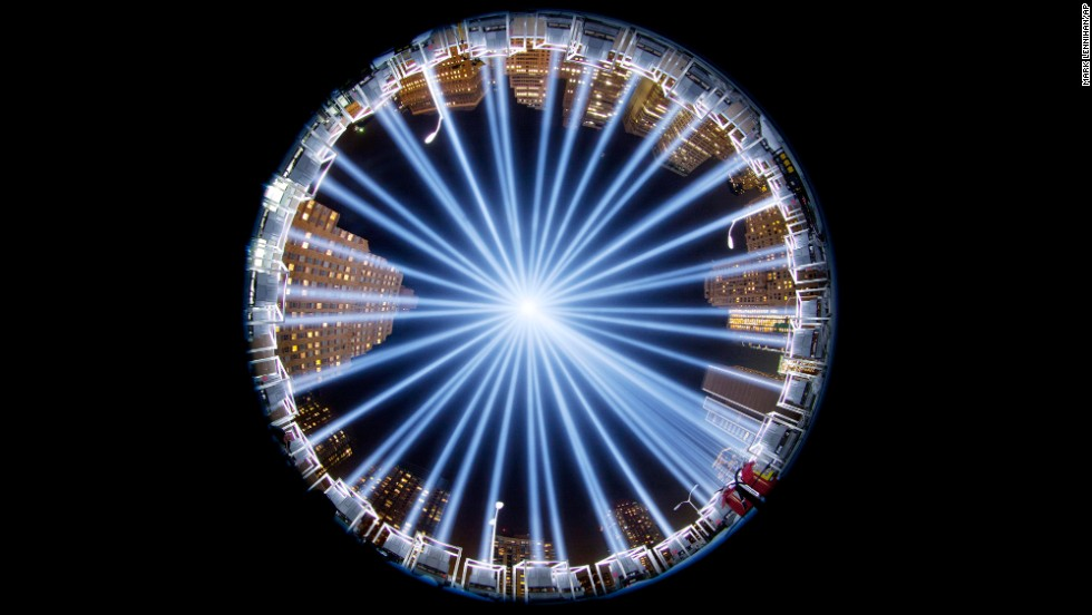 <strong>September 10:</strong> The Tribute in Light, a collection of 88 searchlights next to the site of the World Trade Center, is seen through a fish-eye lens as it rises above buildings in lower Manhattan.