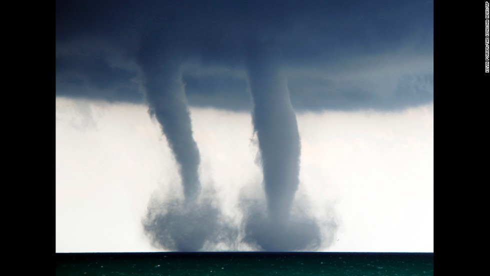 <strong>September 12:</strong> A pair of waterspouts form on Lake Michigan, southeast of Kenosha, Wisconsin.