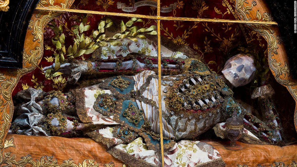 "<em>St. Friedrich at the Benedictine abbey in Melk, Austria, is presented in a reclining pose and holds a laurel branch as a sign of victory</em><br /><br /><strong>CNN: Are there any examples of saints that were clearly inauthentic, but that survived anyway?</strong><br /><strong>PK:</strong> Friedrich should have been destroyed. In the late eighteenth century, the Emperor Joseph II, who at that time ruled Austria, gave instructions that any relics that did not have a firm, acceptable provenance should be removed from their shrines and gotten rid of. He was a man of the Enlightenment, and this decree was to help get rid of silly superstitions and inappropriate veneration. <br /><br />Friedrich could never have passed muster. Think about it: He is supposedly a martyr from the Roman catacombs, but his name is ""Friedrich"" —that's not even a Roman name. It's a German name, it's not even Latin. Probably the only reason he was not destroyed is that the skeleton had been a gift to the monastery from Joseph II's mother, Maria Theresa."