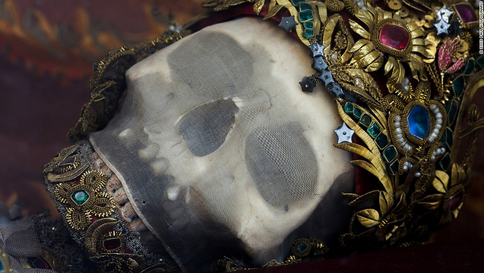 <em>The skull of St. Getreu in Ursberg, Germany is covered in silk mesh and fine wire work set with gemstones</em><br /><br /><strong>CNN:</strong> <strong>Was there any significance attached to the specific jewels chosen to adorn the skeletons?</strong><br /><br /><strong>PK</strong><strong>:</strong><strong> </strong>Not really. There was not necessarily a meaning to the use of say, an amethyst or a pearl rather than something other, but as a whole the elaborate and opulent décor symbolized the idea of heavenly glory. It symbolized the glory which God saves for those who serve him. So the significance of the décor was to remind those within the local congregation of the glory that would await them in heaven if they remained true to the church, and made whatever sacrifices they could in its name.