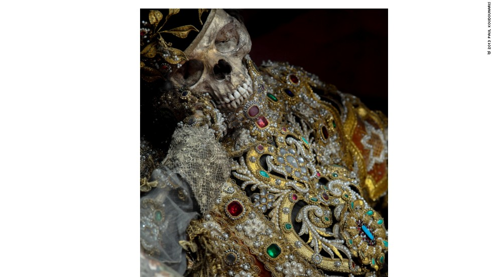 "<em>St Valentinus in Waldsassen, Czech Republic, wears a biretta and an elaborate, elegantly jeweled version of a deacon's cassock to emphasize his ecclesiastical status</em><br /><br /><strong>CNN:</strong> <strong>Which town or church has the best collection of jeweled skeletons today?</strong><br /><br /><strong>PK:</strong> Waldsassen still has ten of these skeletons, all on display, all still resplendent. It's the finest display of jeweled skeletons that still exists. It's like the Sistine Chapel of death in there. The incredible display includes one skeleton on each side altar, ten of them, and then two decorated skeletal busts behind the high altar, for a total of twelve, one for each month of the year. When people write to me, which they often do, and say, ""If I want to see some of these in person, where should I go?,"" I always tell them to go to Waldsassen. It's an intact, incredible display of jeweled skeletons."