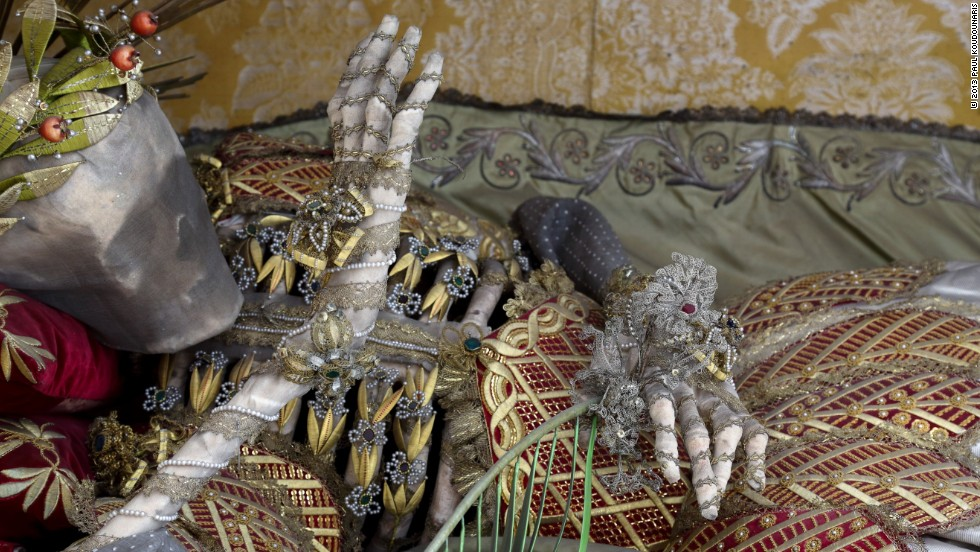 <em>St. Vincentus rests in Stams, Austria. His ribs are exposed beneath a web of golden leaves</em><br /><br /><strong>CNN: At any point did you share the awe of the 16th century Catholics who venerated these objects?</strong><br /><br /><strong>PK: </strong>Yes, definitely. When I was photographing them I was often possessed of a certain kind of empathy, this feeling of the veneration and love that was once given to them. It was an awesome but also sad feeling to know what these skeletons had once been, the power they were once thought to hold, and the meaning they once held for so many people, but were now denied. It was an often profound experience, measures of awe and sadness, and especially the latter.