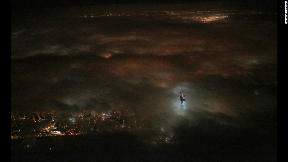 <strong>March 11:</strong> The One World Trade Center building emerges from the clouds in New York's night sky. Construction on the office complex, which is going up on the site of the original World Trade Center, is set to be completed in early 2014.