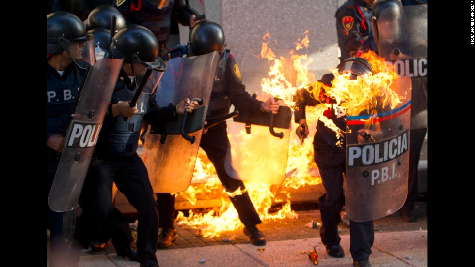 <strong>October 2:</strong> A police officer is engulfed in flames after being hit by a Molotov cocktail thrown by protesters marking the anniversary of the Tlatelolco massacre in Mexico City.