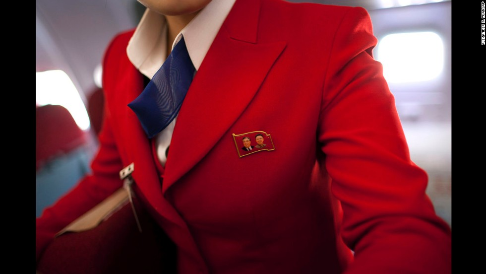 <strong>April 11:</strong> An Air Koryo attendant wears a pin showing portraits of the late North Korean leaders Kim Il Sung and Kim Jong Il. Air Koryo is the world's only 1-star airline on Skytrax, a consultancy that has ratings and reviews for more than 681 airlines.