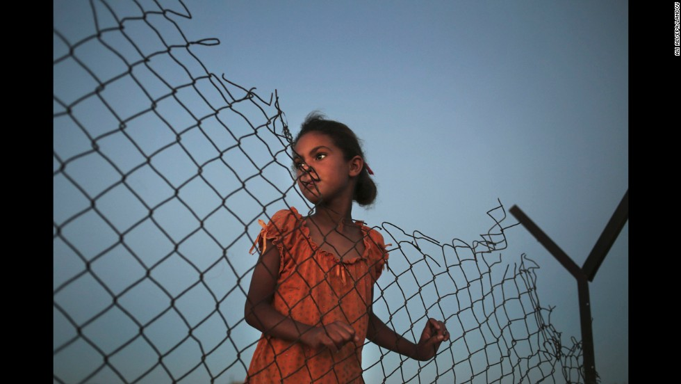 <strong>July 29:</strong> A Palestinian girl plays beside her family's tent in a poverty-stricken area of Gaza.