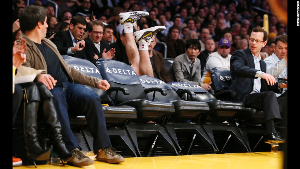 Steve Blake of the Los Angeles Lakers falls over empty courtside chairs trying to save a ball from going out of bounds during a game against the Phoenix Suns on February 12 in Los Angeles. The Lakers won 91-85.